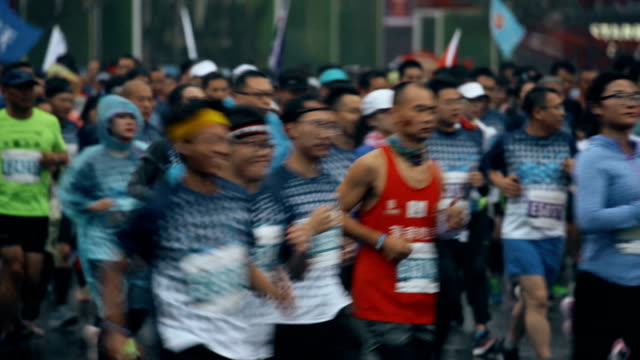 view of xi'an international marathon races,china. - トラック競技点の映像素材/bロール
