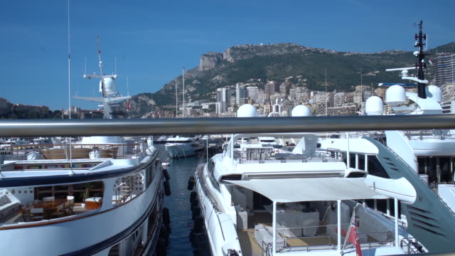 view of yachts moored in the harbour in monaco - monaco stock videos and b-roll footage