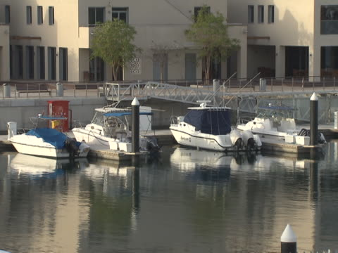 view of yachts moored in yas island marina. - luxury stock videos & royalty-free footage