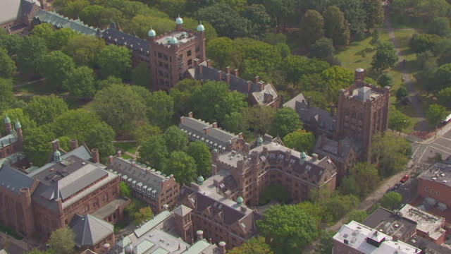 ws aerial pov view of yale repertory theatre on chapel street on yale university campus / new haven, connecticut, united states - ivy league university stock videos and b-roll footage