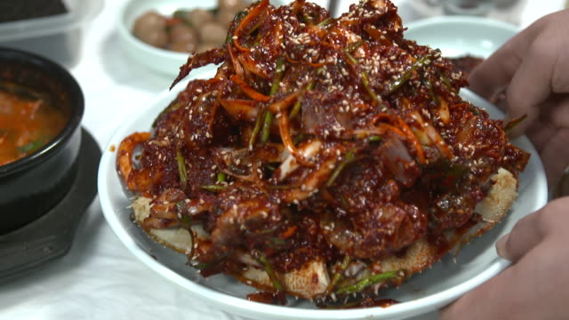 view of yangnyeom gejang(seasoned marinated raw crab) laying on the table - marinated stock videos and b-roll footage