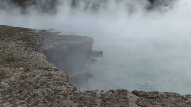 view of yellowstone national park in wyoming united states - brodelnd stock-videos und b-roll-filmmaterial