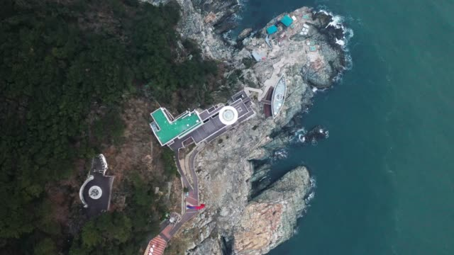 view of yeongdo lighthouse in taejongdae park(the southernmost tip of yeongdo-gu district), busan - natural landmark stock videos & royalty-free footage