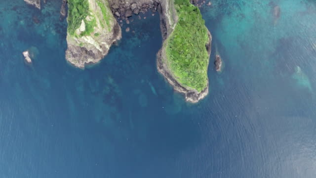 view of yonggul cave and beach in ulleunggdo island (the sole island-city in the korea's east sea) at summer - north gyeongsang province stock videos & royalty-free footage