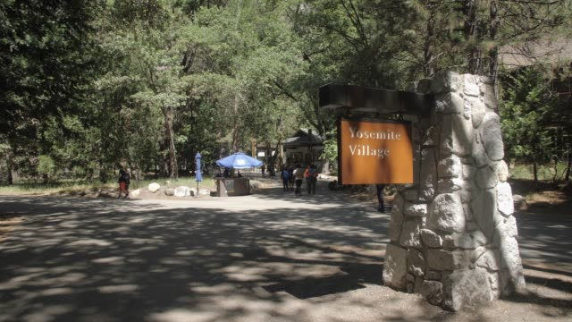 view of yosemite village sign, visitors and visitors centre, yosemite village, yosemite national park, unesco world heritage site, california, usa, north america - western script stock videos & royalty-free footage