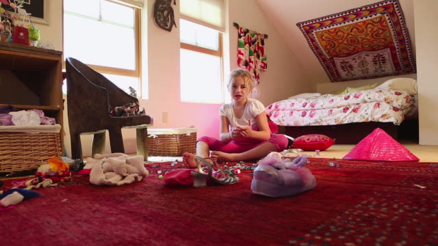 ws view of young girl sitting and singing in her room / lamy, new mexico, united states - lamy new mexico stock videos and b-roll footage