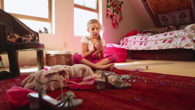 ws view of young girl sitting and singing in her room / lamy, new mexico, united states - lamy new mexico stock videos & royalty-free footage