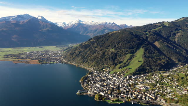 view of zell am see village and lake zell in european alps, austria - tyrol state austria stock videos and b-roll footage