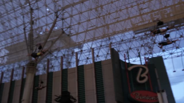 view of zip wire riders on fremont street experience, downtown, las vegas, nevada, united states of america, north america - zip line stock videos & royalty-free footage