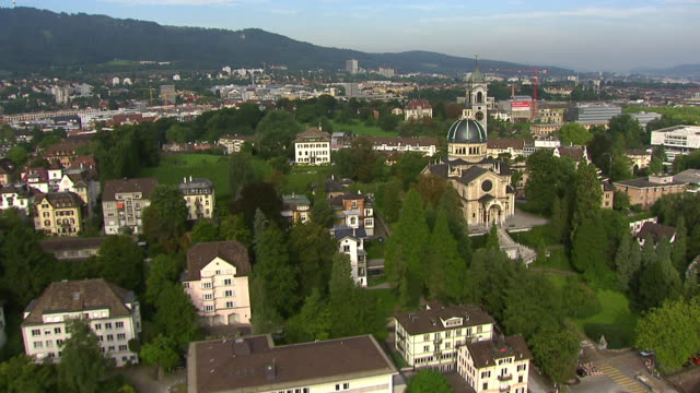 WS AERIAL View of Zurich Enge with church and Shopping Zurich Sihlcity at highway A3W / Zurich city, Zurich, Switzerland