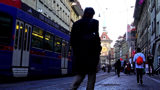 view of zytglogge clock tower in kramgasse street - tram stock-videos und b-roll-filmmaterial