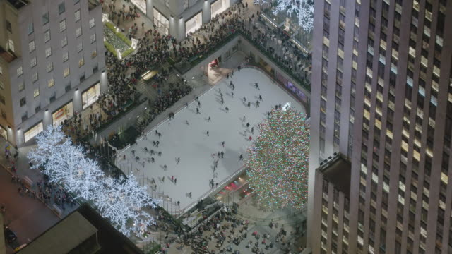 AERIAL MS ZI View office skating at rink at Rockefeller center / New York City
