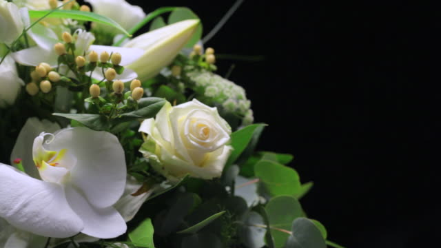 ms cu pan view ofmixed bouquet of white flowers / london, united kingdom - bouquet stock videos & royalty-free footage