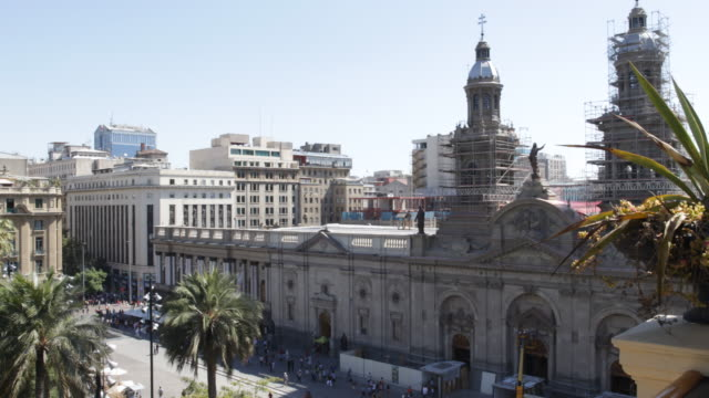 stockvideo's en b-roll-footage met view on a terrace with palms looking at the metropolitan cathedral in santiago de chile - sociale geschiedenis
