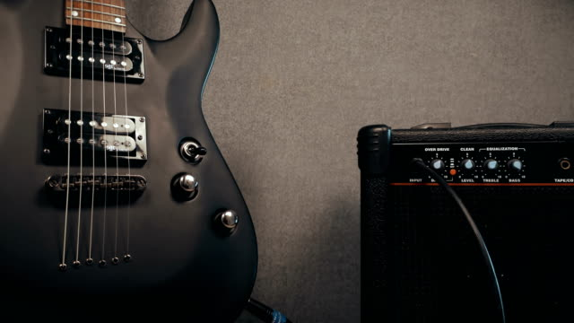 view on amplifier knobs, plugs and electric guitar - electric guitar stock videos and b-roll footage