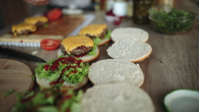 view on delicious homemade hamburgers - unhealthy eating stock videos & royalty-free footage