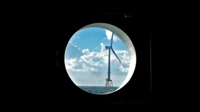 view on offshore wind-turbine true round window from sailing vessel - blade stock videos & royalty-free footage