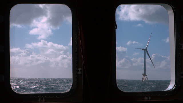 view on offshore wind-turbine true windows from moving sailing vessel. 8mw wind turbine, 82m blade. sunny weather, dramatic sky. - blade stock videos & royalty-free footage