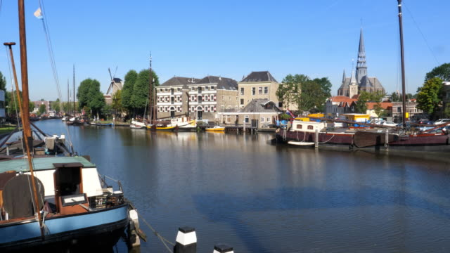 view on skyline of gouda, the netherlands. - town stock videos & royalty-free footage