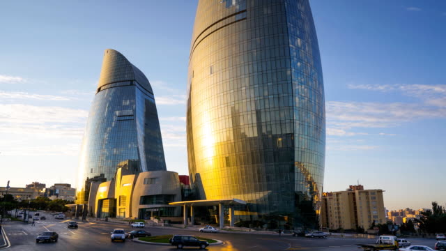 tl view on the flame towers, sunset / azerbaijan, baku - baku video stock e b–roll