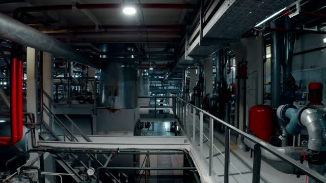 view on the interior of a building boiler room, with cooling and heating system of pipelines - order stock videos & royalty-free footage