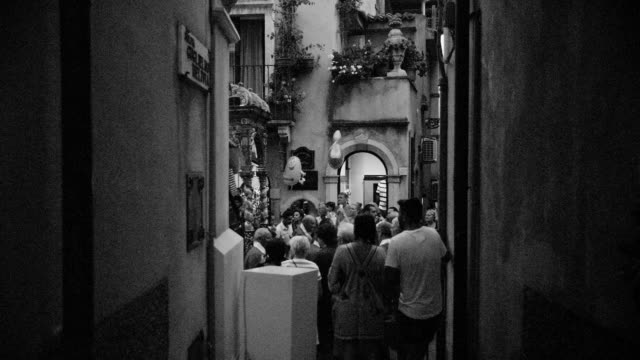 View on the procession and the statue of Santa Agata from a side street