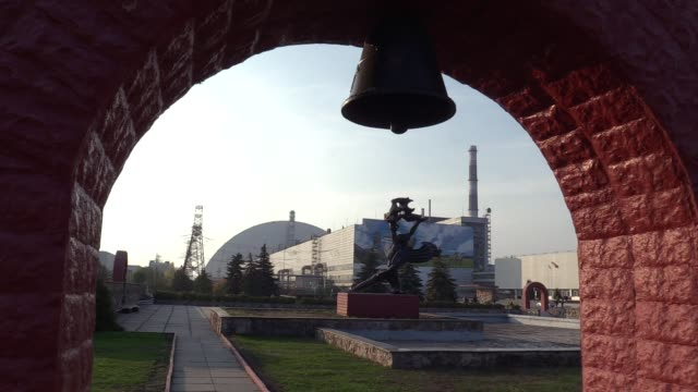view on the safe confinement over the 4th block of chernobyl nuclear power plant and a giant mural of author valerii korshunov, during a press tour... - 18 23 months stock videos & royalty-free footage