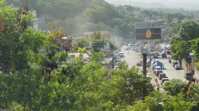 view on the streets of port-au-prince with temporary camps and cars - port au prince stock videos & royalty-free footage