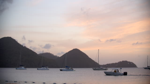 view out into the bay at dusk / st lucia, caribbean - st lucia stock videos & royalty-free footage