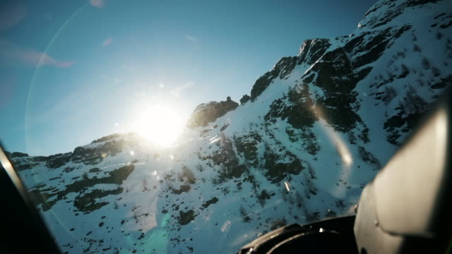 view out of helicopter cockpit over mountains at sunrise - helicopter stock videos and b-roll footage