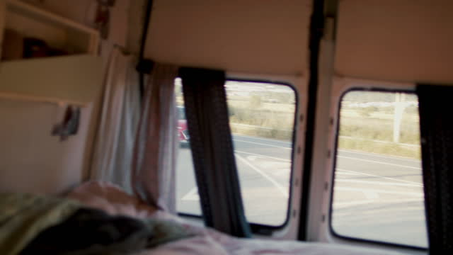 view out the window of cozy camper on the road - passenger seat stock videos & royalty-free footage