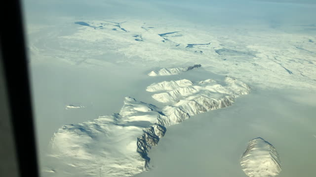 view outside an airplane window of greenland - greenland stock videos & royalty-free footage