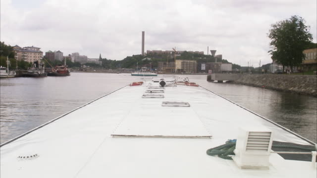 view over a canal in stockholm, sweden. - boat point of view stock videos and b-roll footage