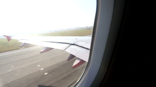 View over airplane wing during take off