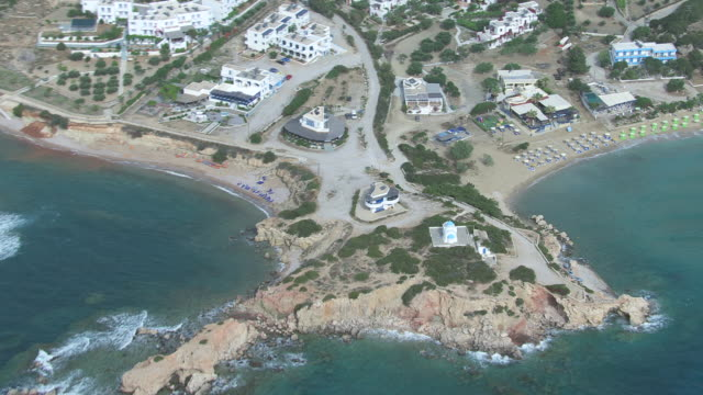WS AERIAL DS View over bay besides hotels / Karpathos, Dodecanese, Greece