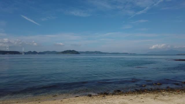 view over bay of oshima, ehime prefecture and kurushima kaikyo bridge - onomichi hiroshima stock videos and b-roll footage