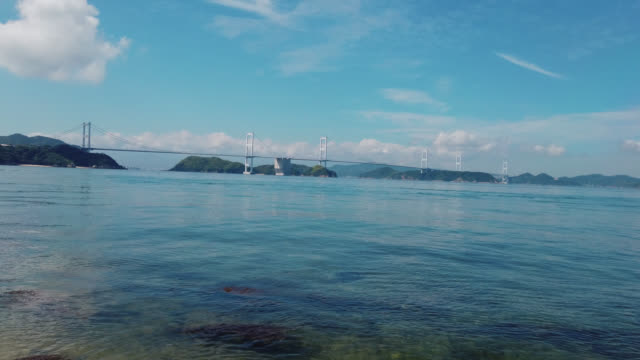 view over bay of oshima, ehime prefecture and kurushima kaikyo bridge - nishiseto expressway stock videos & royalty-free footage