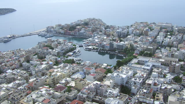 WS AERIAL DS View over buildings in down town and bay / Agios Nikolaos, Crete, Greece