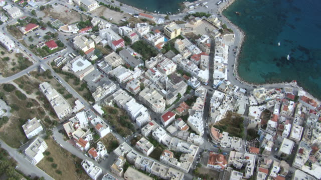 WS AERIAL View over buildings top and harbor/ Karpathos, Dodecanese, Greece