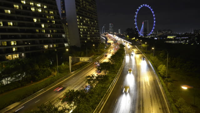 ws t/l ha view over cars running on highway at night / singapore - main road stock videos & royalty-free footage