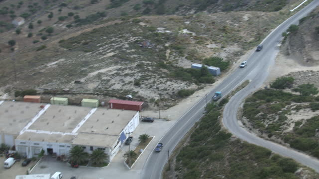 WS AERIAL TS View over cars running on long street / Karpathos, Dodecanese, Greece