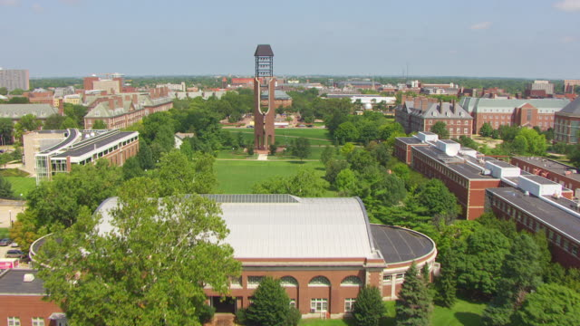 WS AERIAL POV View over cemetery and campus to McFarland Memorial Bell Tower / Champaign, Illinois, United States