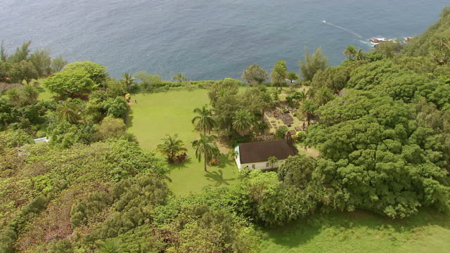 WS DS AERIAL View over Charles Lindbergh church and grave site on island of Maui / Hawaii, United States