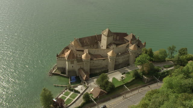 ws ds aerial view over chateau de chillon with lake geneva / veytaux (montreux), switzerland - montreux stock videos and b-roll footage