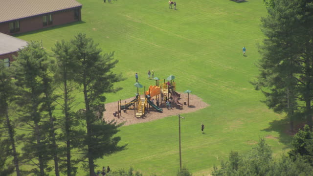 ws zo aerial view over children playing at playground and green bank elementary and middle school in pocahontas county / green bank, west virginia, united states - playground stock videos & royalty-free footage
