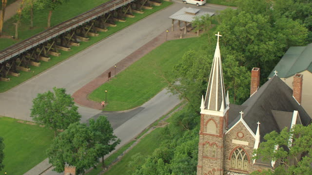 ms zo aerial view over church steeple and town of harpers ferry in jefferson county / west virginia, united states - steeple stock videos & royalty-free footage