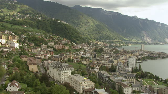 ws aerial view over city of montreux and train station with lake geneva / montreux, switzerland - montreux stock videos & royalty-free footage