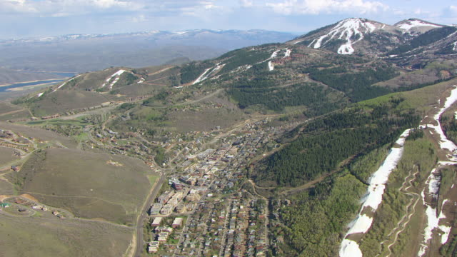 ws aerial ds view over city / park city, utah, united states - park city utah stock videos and b-roll footage