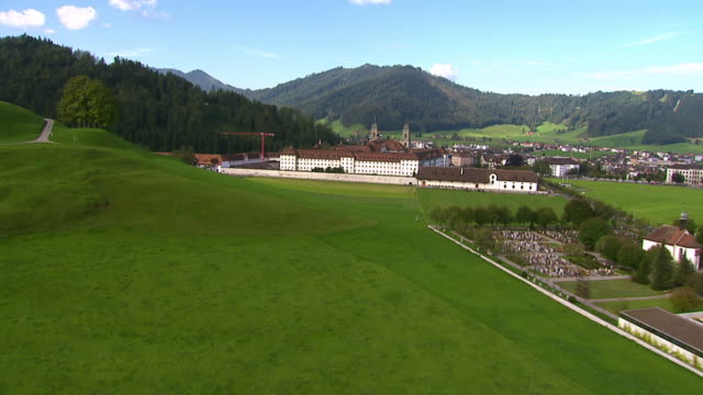 WS AERIAL View over city with Einsiedeln abbey landscape / Einsiedeln, Schwyz, Switzerland