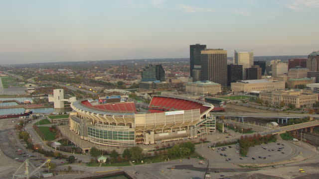 ws ds aerial view over cleveland browns stadium with downtown buildings / cleveland, ohio, united states - cleveland ohio stock videos and b-roll footage